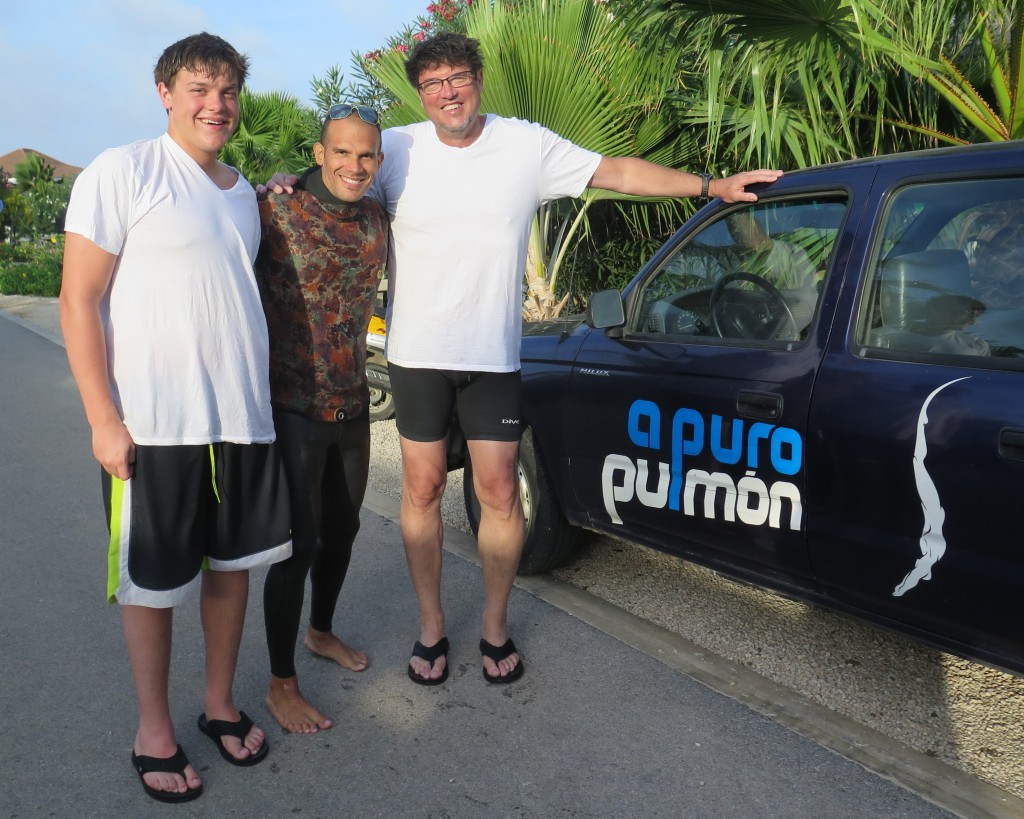 Image: Jens, Carlos, and Dr. Chuck in Bonaire next to Carlos' dive truck