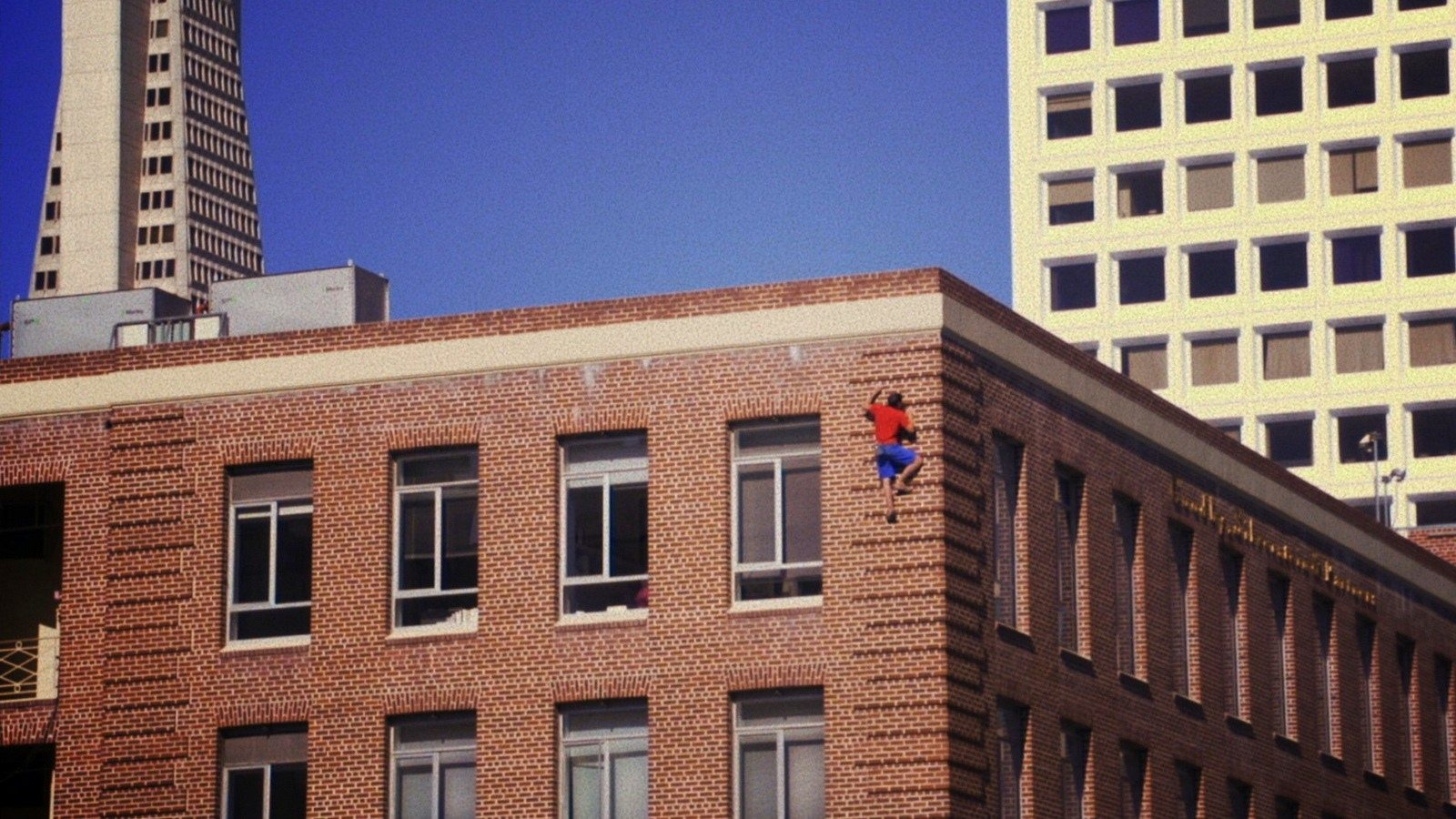 Image: Expert Rock climber Alex Honnold climbs buildings along with natural rock faces.
