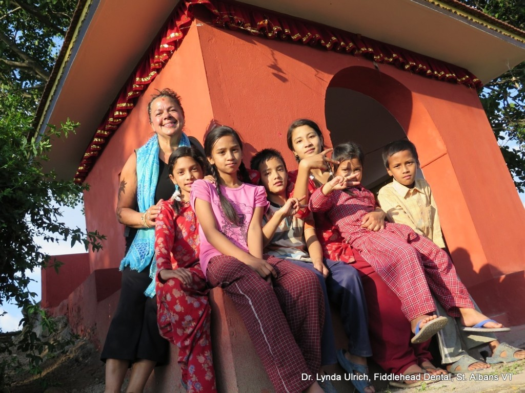 Image: Dr. Lynda of everwideningcircles.com in Nepal with a group of school children