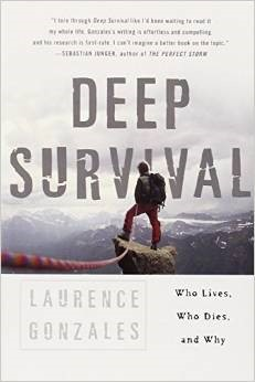 "Image: The cover of ""Deep Survival"" by Laurence Gonzales. A picture of a man on top of a cliff. ""Who Lives, Who Dies, and Why"""