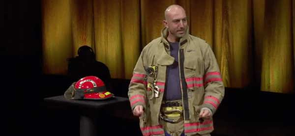 Image: Fireman on stage at the TED conference, life lesson from a volunteer firefighter