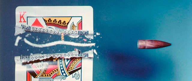 Image: Bullet through a King of Hearts card