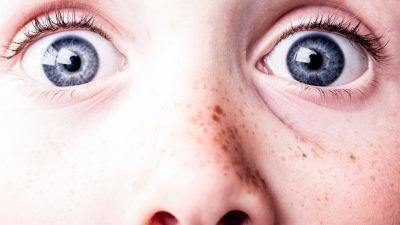 Image: blue eyes of a surprised kid