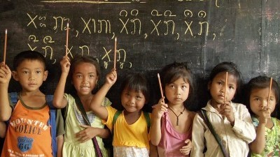Image: School children holding up pencils