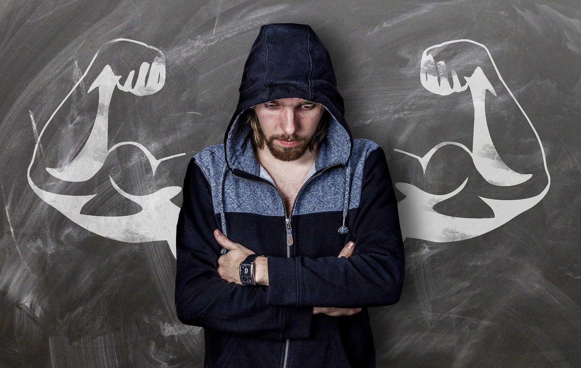 Image: A man wishing he was muscular