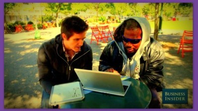 Image: Computer programmer teaches homeless man coding