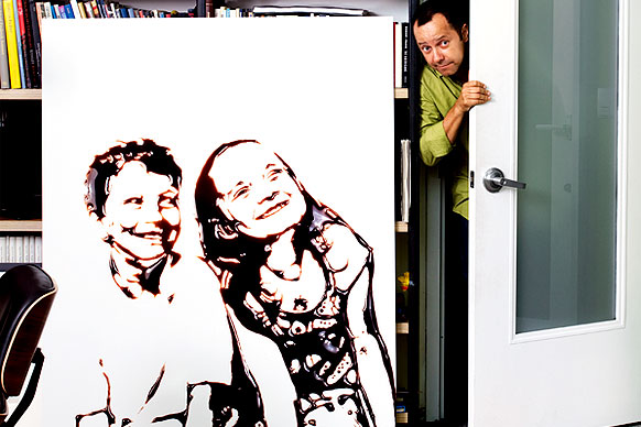 Image: Artist Muniz with a portrait done with chocolate
