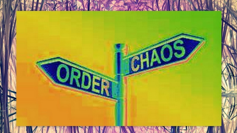 Image: A Street sign, but instead of street names, one way points to chaos and the other way points to order