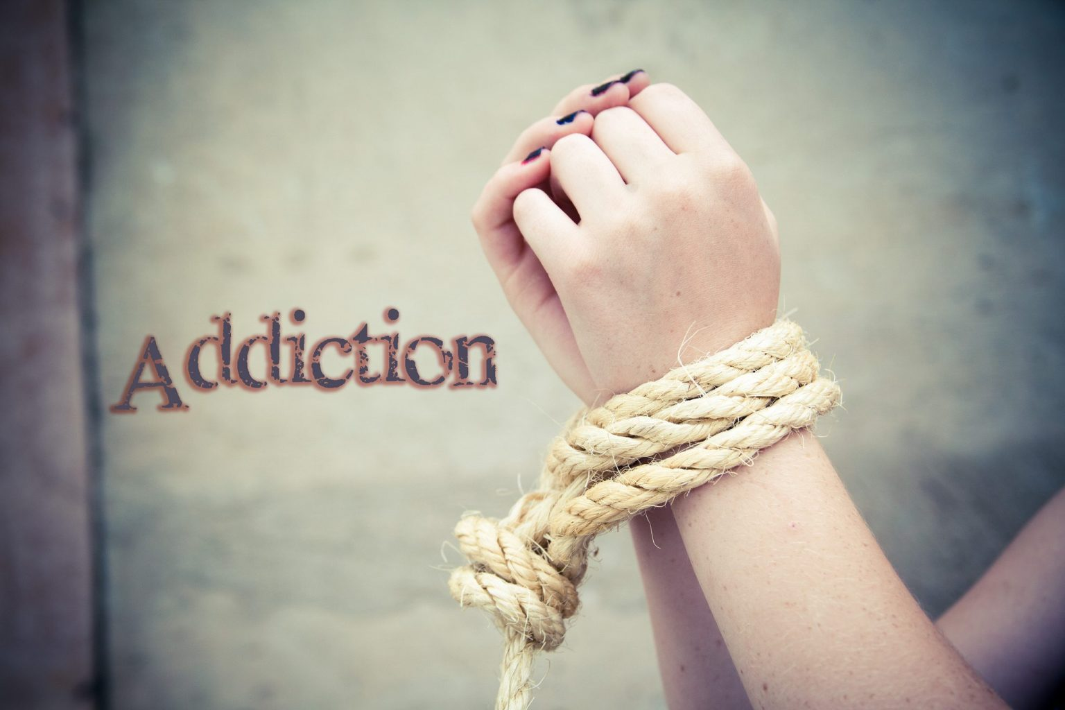Image: hands tied by addiction