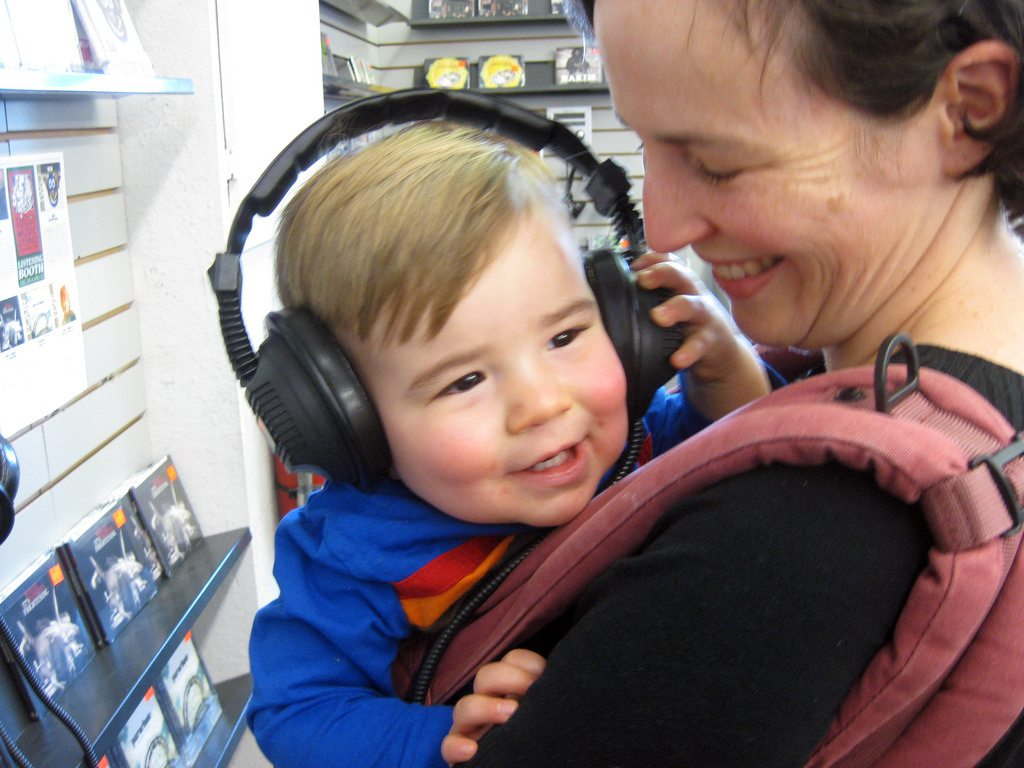 Image: A child listening to music through headphones