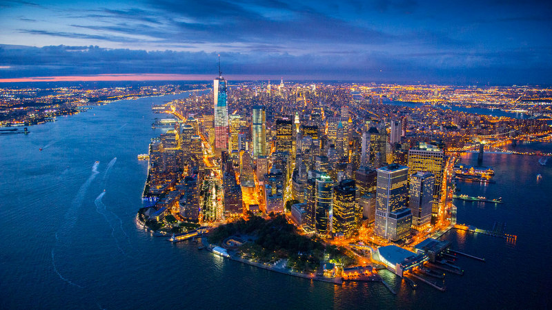 Image: Manhattan at night from the air by Jason Hawks