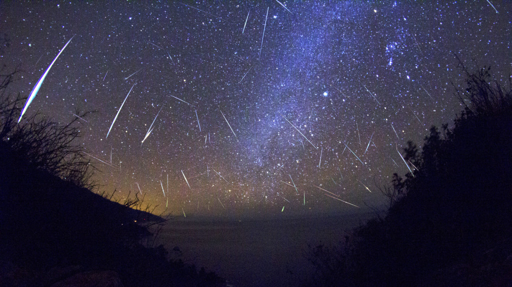 Image: the Perseid Meteor shower in a brilliant dark blue night sky