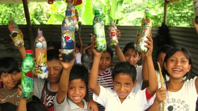 Image: Children holding up plastic bottles