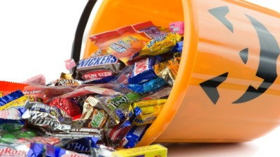 Halloween candy spilling out of bucket