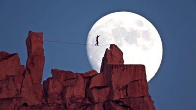 Image: Dean Potter Rope Walking Over Rocks With Moon Behind