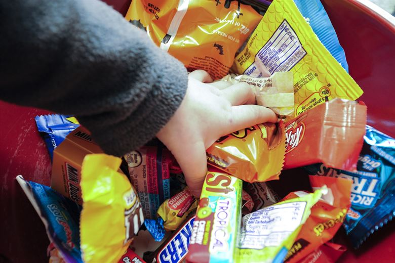 Image: Child reaches in for Halloween candy