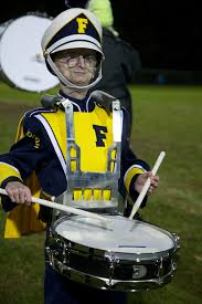 Image: Sam Burns playing the drums in the band