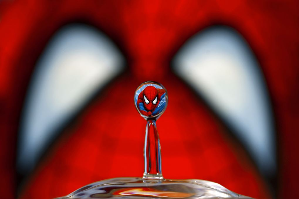 Image: Corrie White's spider man's face reflected in a drop of water