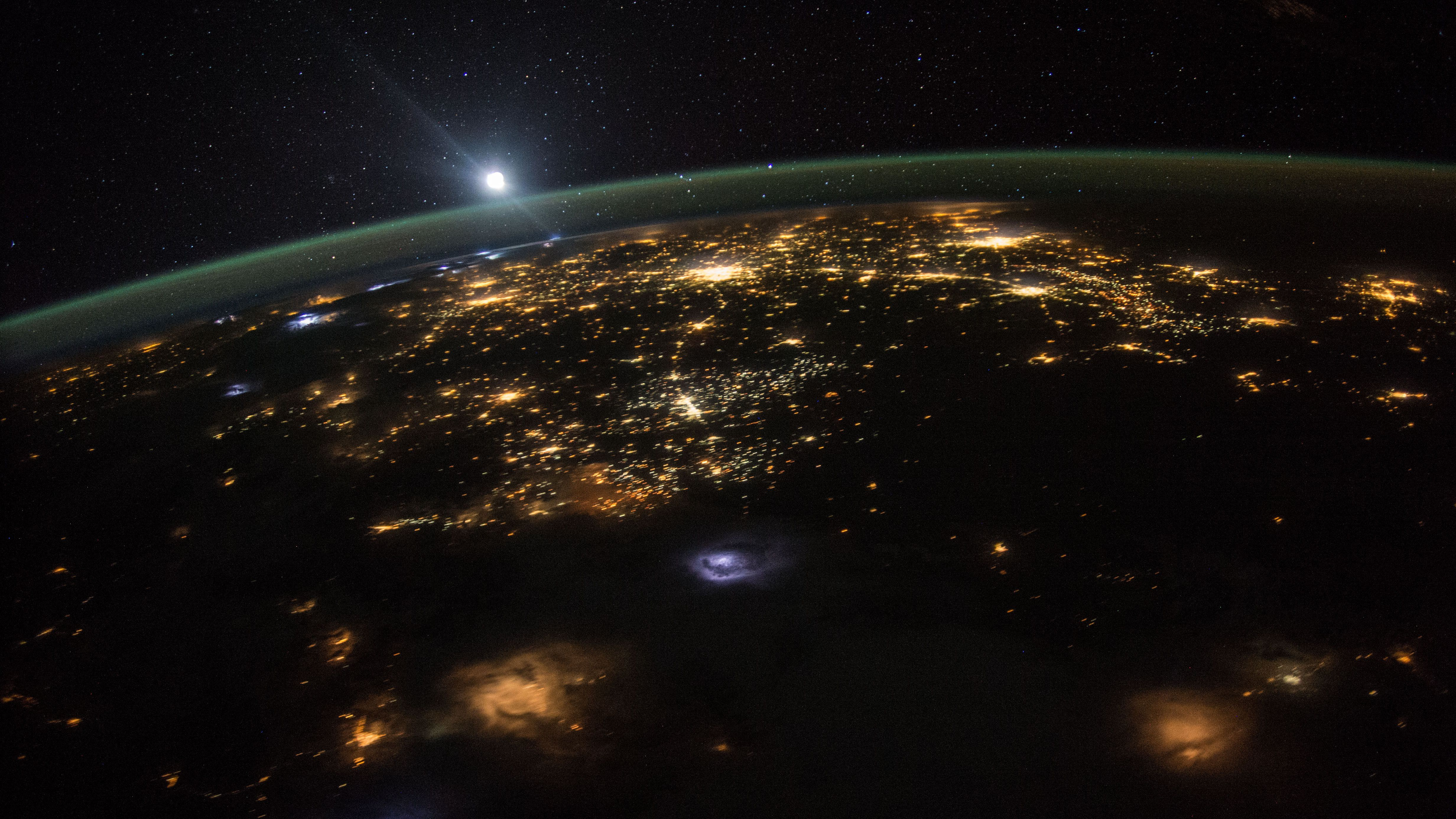 Astronauts talk about seeing earth from space: View of Earth from the ISS: Sun rising over earth.