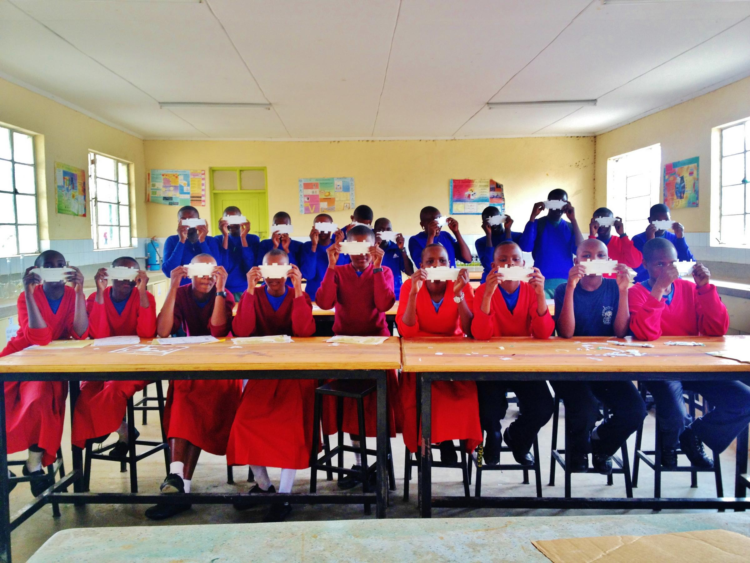 A classroom of students using the Foldscope