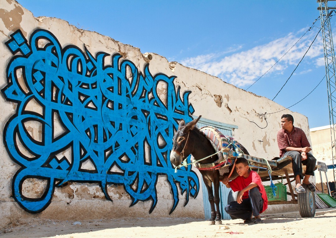 The Message And Meaning Of El Seed 39 S Calligraffiti Ewc