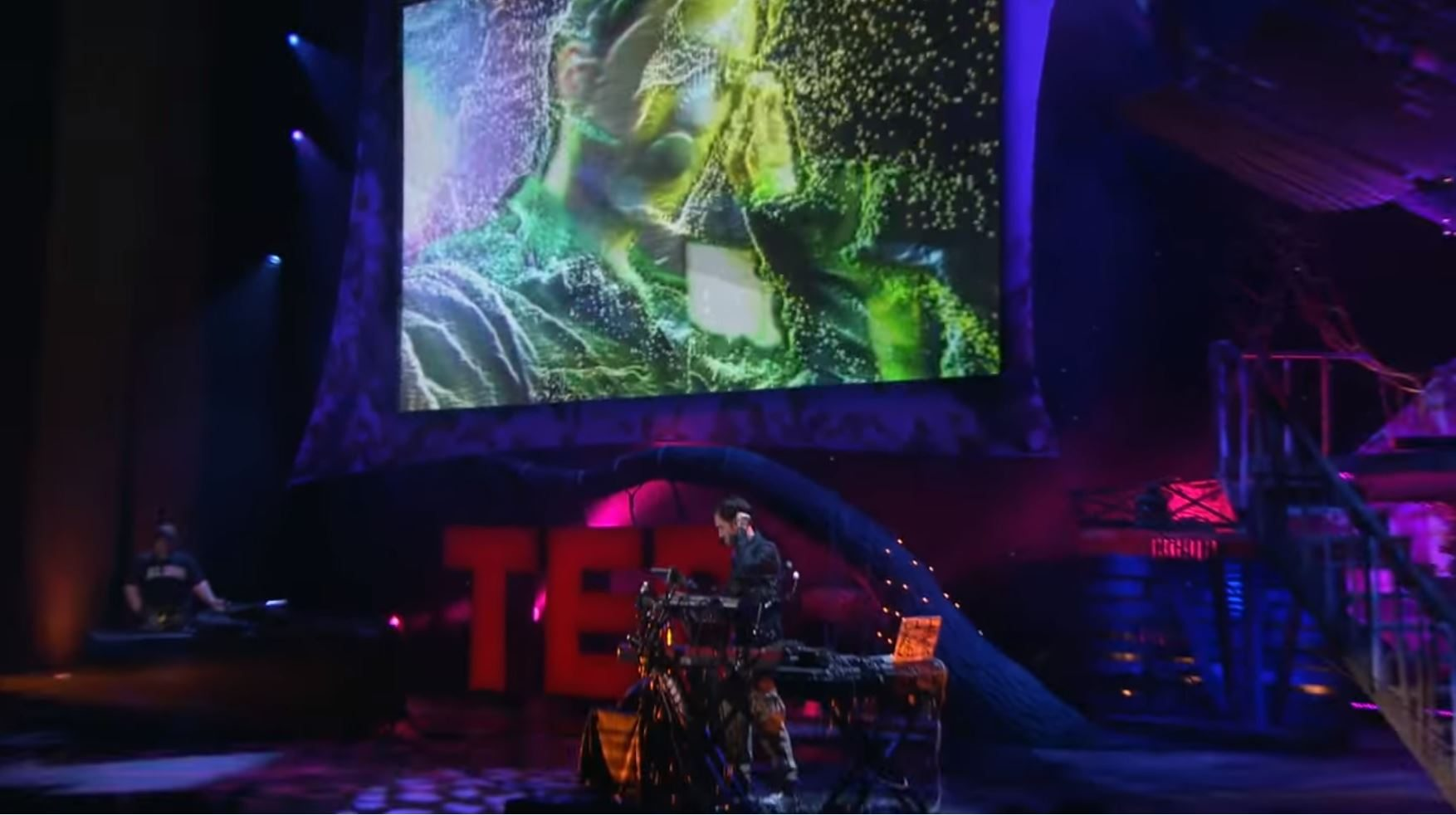 Image: Darren Foreman on the TED stage, showing off the human voice remixed