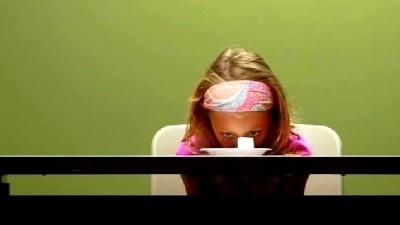 Image: Girl staring at a marshmallow