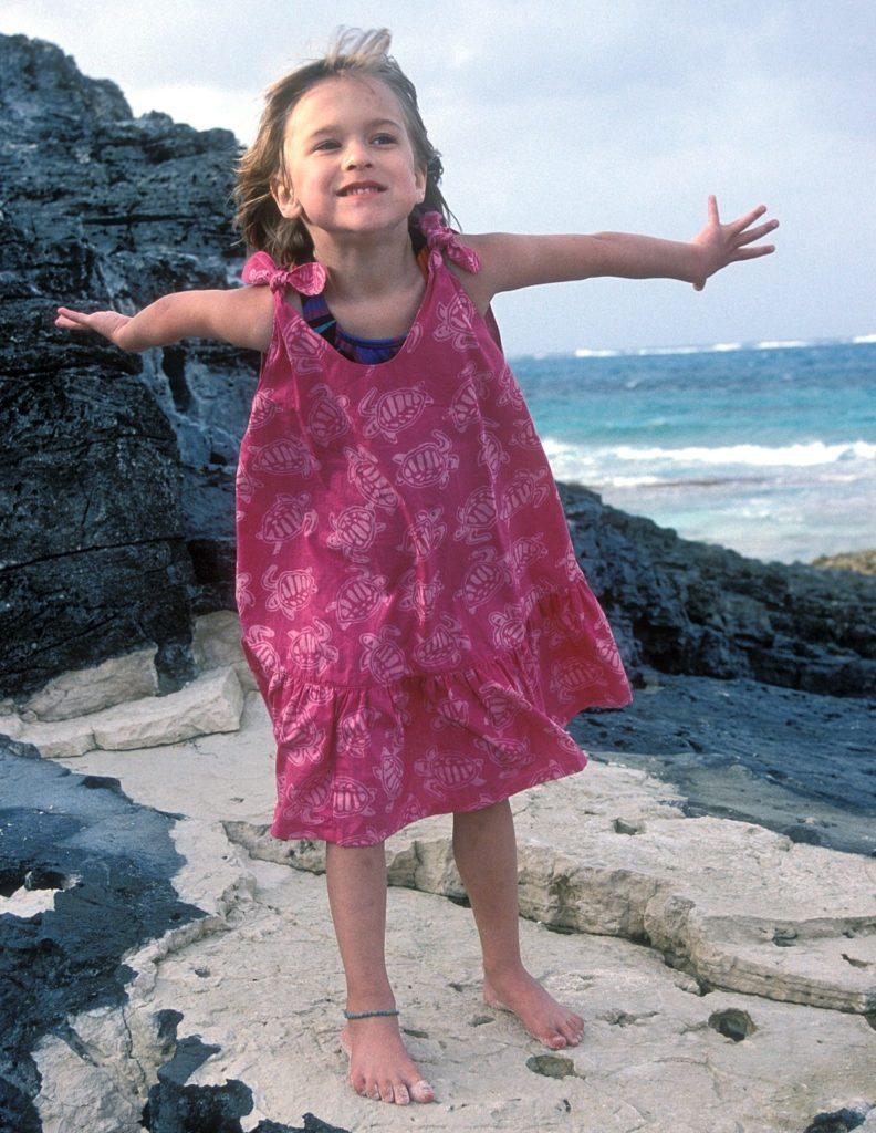 Image: Little girl pretending to fly