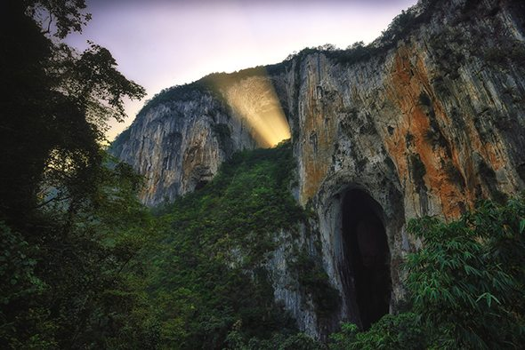 Image: On expedition with National Geographic light shining through a rock arch