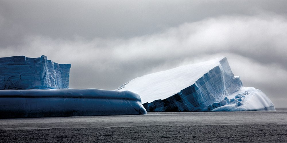 Image: Strangely shaped blue iceberg with rolled top