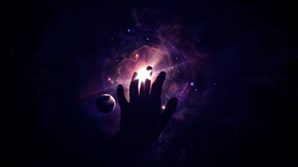 Image: Hand reaching out to the universe in search of the farthest reaches of space travel