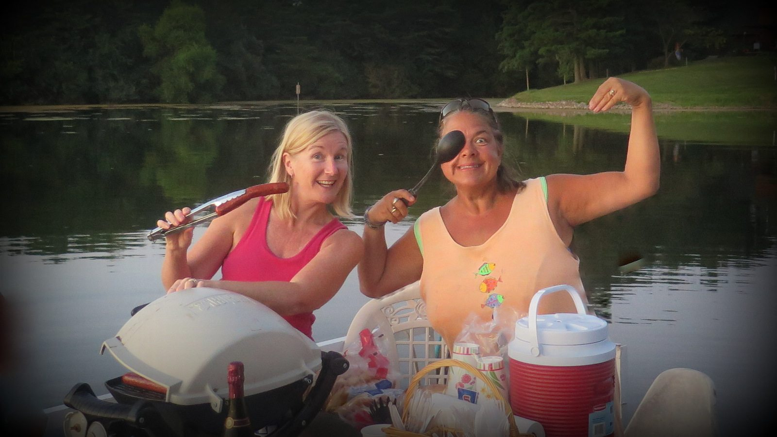 Image: Two Joyful Ones cook on a boat for everyone