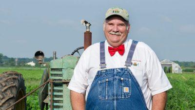 Farmer-Lee-Jones_Infront-of-tractor_08222014