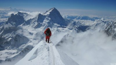 Image: a lone climber on a ridge of Everest