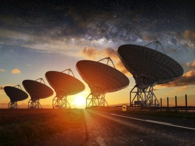 Image: SETI radio telescopes lined up in sunset in search of intelligent beings