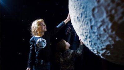 child touching moon