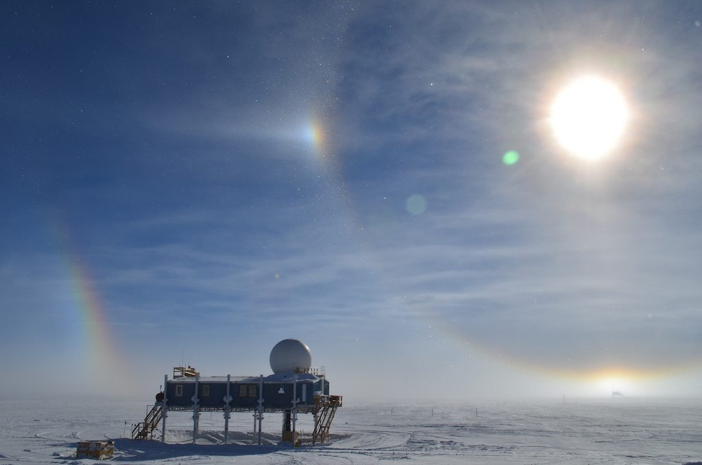 Image: Sundog above a polar science station, two haloes circling the sun