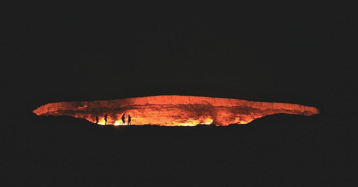 Image: Far away image of a volcano pit burning in the dark of night