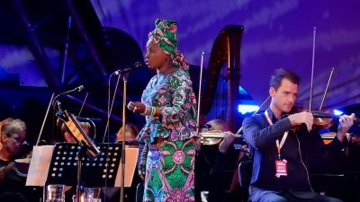 Image: Angelique Kidjo on stage with an orchestra