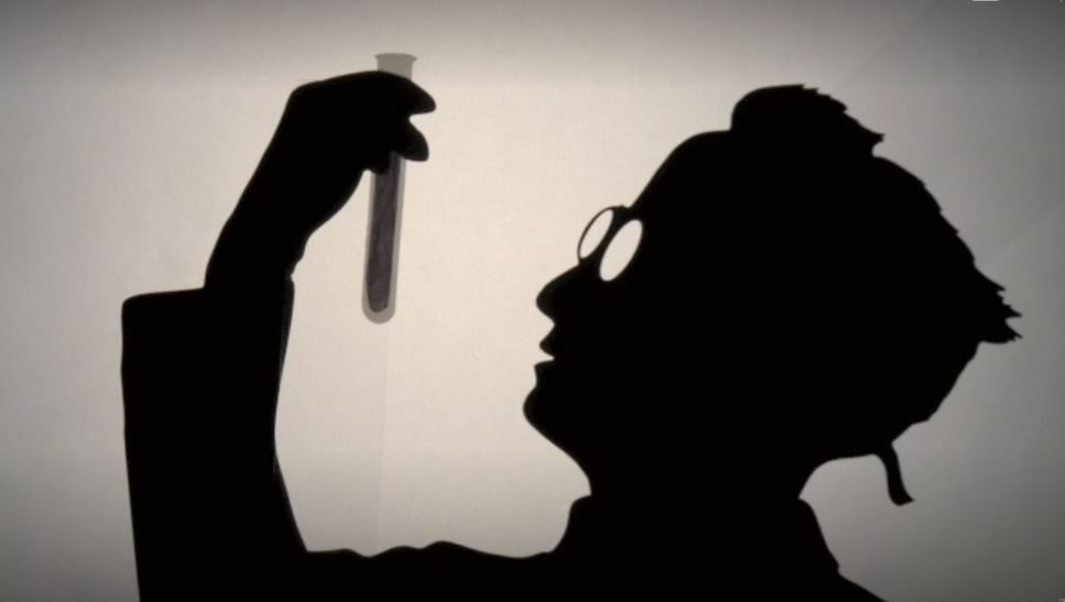 Image: Silhouette of forger looking at a test tube