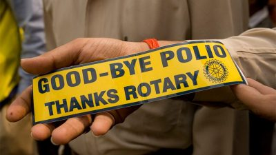 """Image: A bumper sticker that says """"Good by Polio, Thanks Rotary"""""""