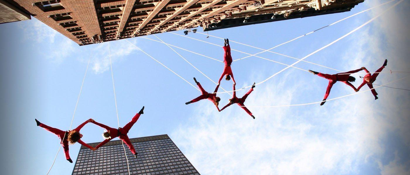 Image: BANDALOOP dancers hanging off the side of a building dancing