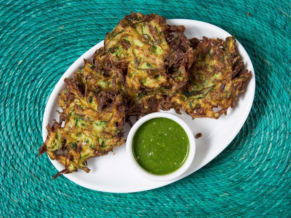 Image: Crispy Zucchini strings fried to perfection with a side of green sauce