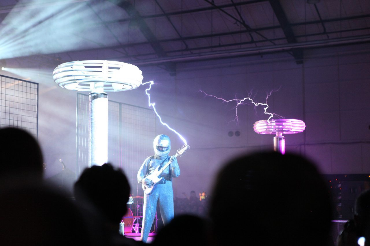 Image: A member of ArcAttack making music with Tesla coils
