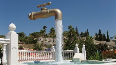 Image: Illusion of a giant faucet gushing water, with no apparent connection