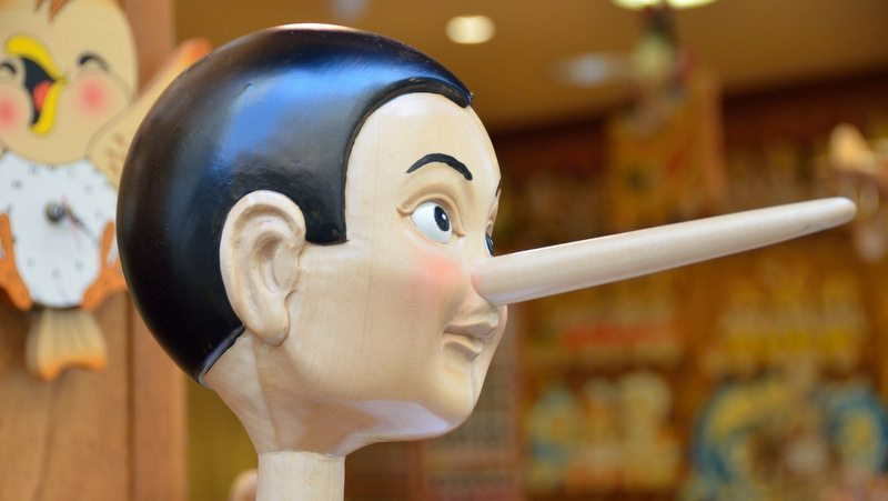 Image: A Pinocchio puppet with a very long nose