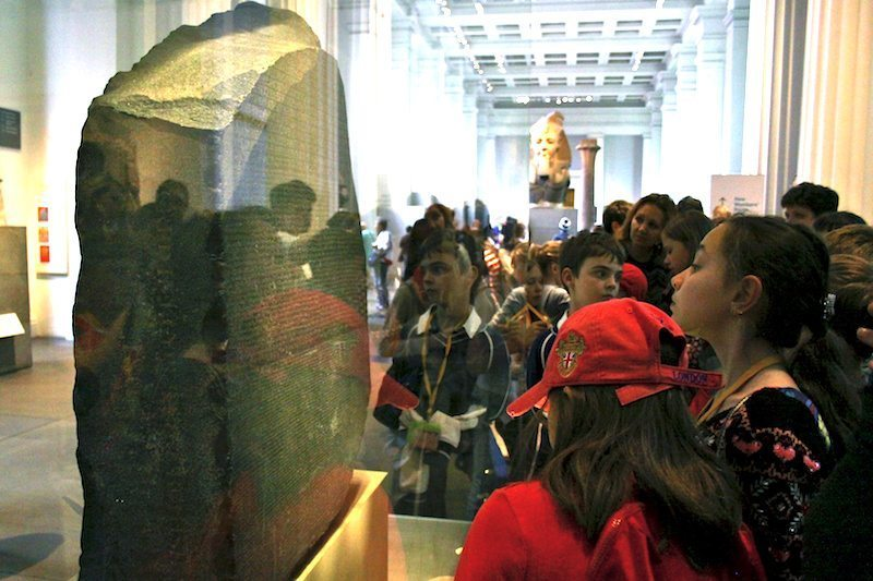 Image: Students looking at the Rosetta Stone in The British Museum