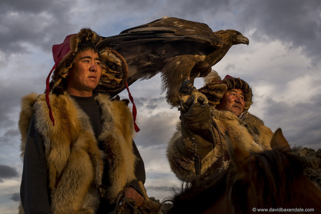 Image: Golden Eagle Hunters stand with their Eagle ready to hunt
