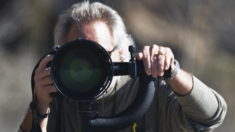 Image: Photographer taking an image with a large lens