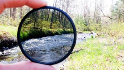 Image: A view of a river partly viewed through a filtered lens